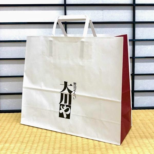「大川や」特製オリジナル紙袋をお付けします。